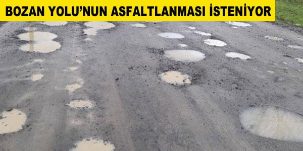 Esnaf Bozan Yolu'nun asfaltlanmasını istiyor